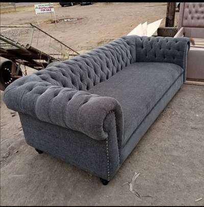 A stone  grey 3seater chesterfield. image 1