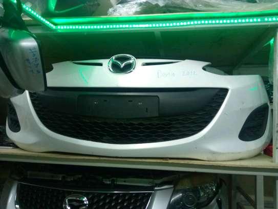 Mazda demio front bumper image 1