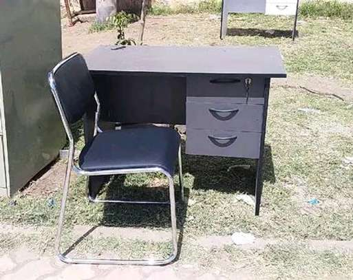 Office table with grommet for cable and armless office chair image 1