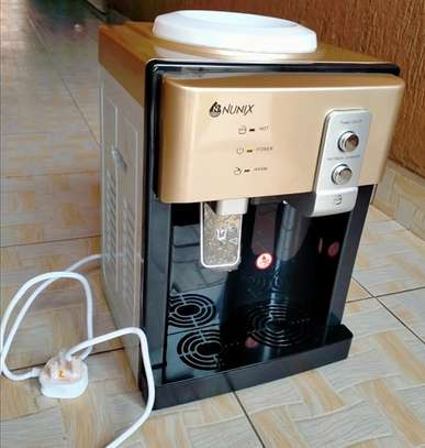 hot and normal table top nunix water dispenser image 1