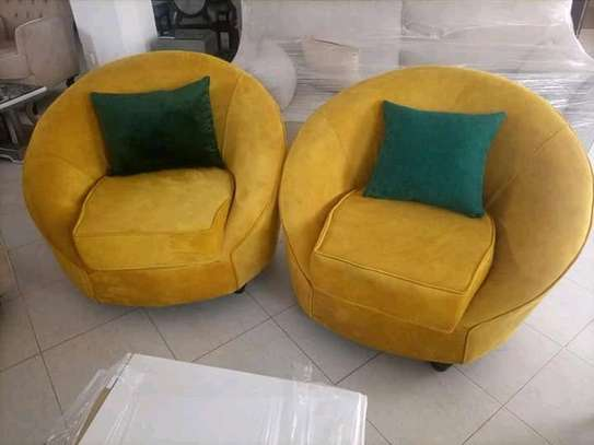 Swivel /rounded chesterfield and pipings sofas image 1