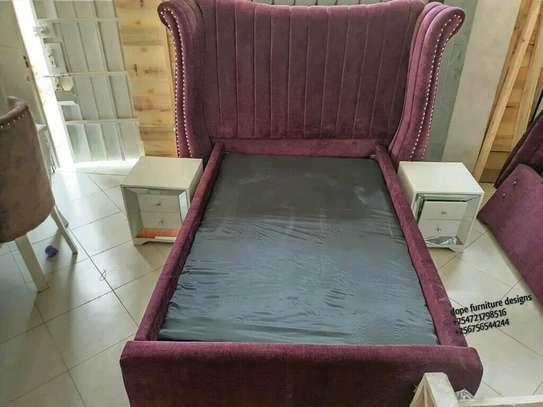 Upholstery 6*6 bed/maroon velvet bed. image 1