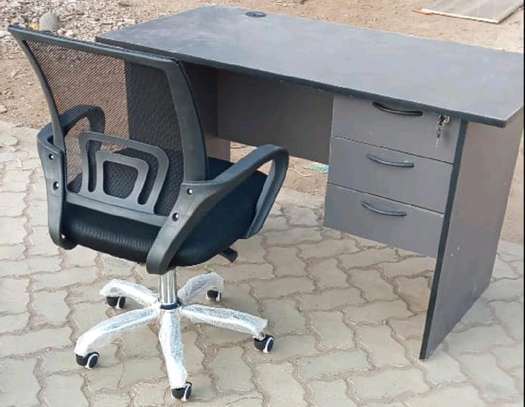An office table with an adjustable black armrest seat