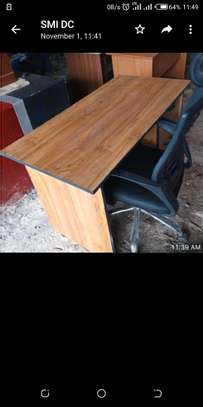 An office table with a classic and stylish headrest chair image 1
