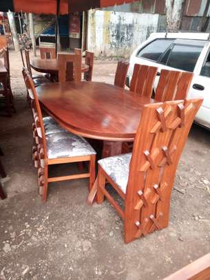 6 Seater Mahogany Oval Dining Table (X designed chairs)