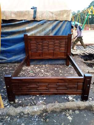 Wooden (queen size ) Bed.