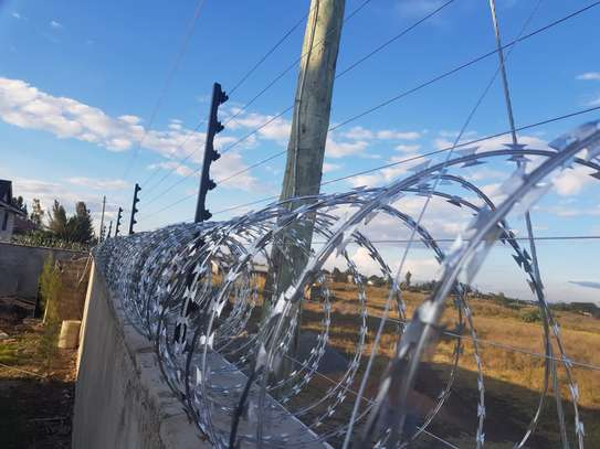 Electric Fence and Razor wire installation... image 2