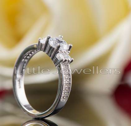 A sparkling & shinny silver engagement ring. image 1