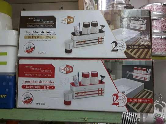 Toothpaste dispenser/toothbrush holder image 2