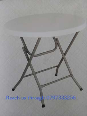 Strong foldable tables are available on offer image 1