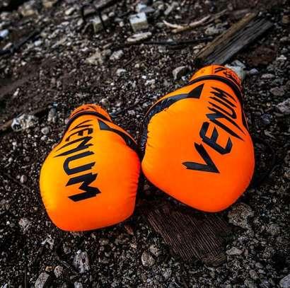 Orange venum boxing gloves image 1