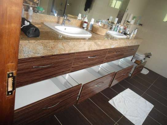 Kitchens, Wardrobes and bathroom vanities