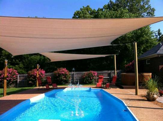 Swimming pool canopies