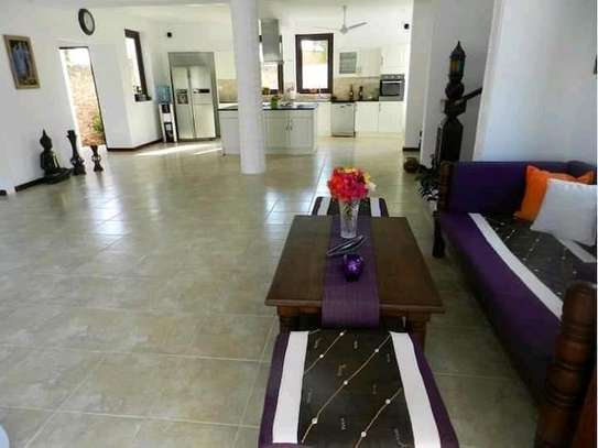 3 bedroom fully furnished own compound image 12