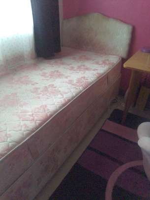 Single pink divan bed with mattress