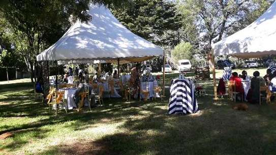 Tents,chairs,tables and roman flower stands and decor