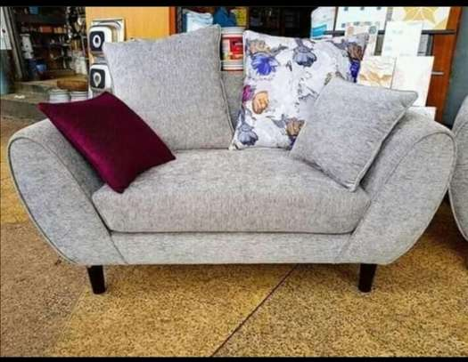 A grey two seater, back permanent back pillowed. image 1