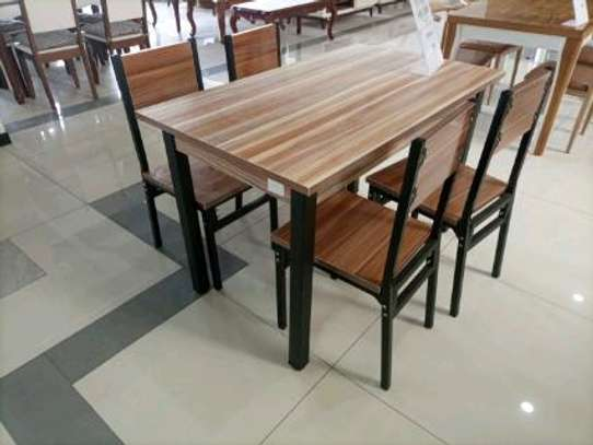 Wooden dinning table image 1