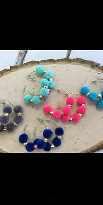 Hoop pompom earrings available in wholesale and retail