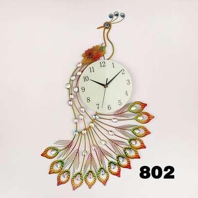 Slim peacock clock image 1