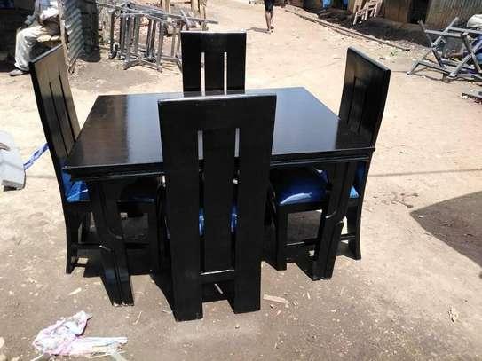4-seater mahogany-wood dining set. image 1