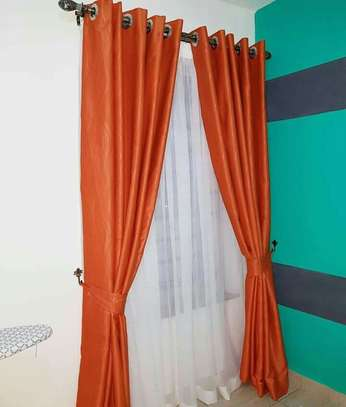curtains and curtain blinds. image 2