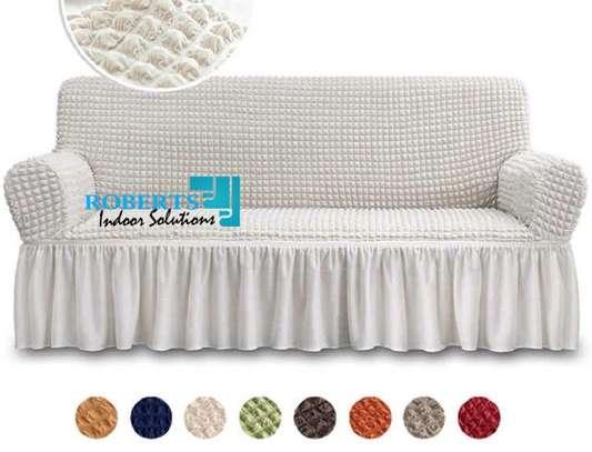 Cream white elastic sofa cover 7 sitter image 1