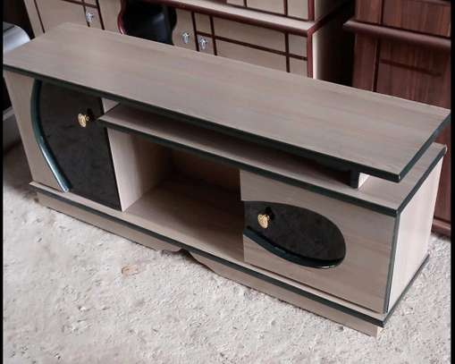 Against the wall placed tv cabinet with doors