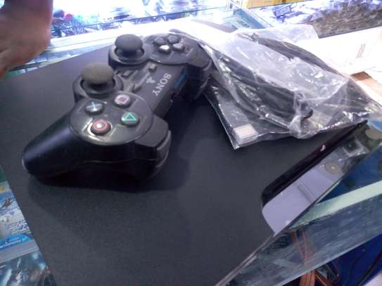 ps3 console available with 2 controllers image 1
