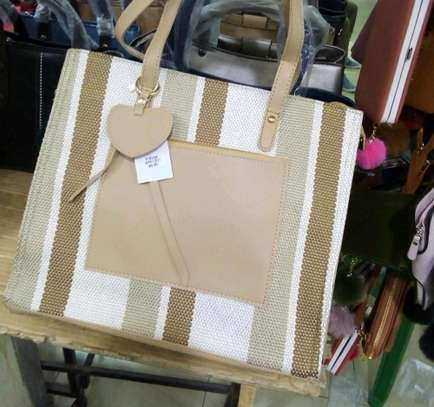 Beige and white quality handbags image 1