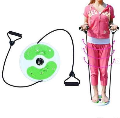 Body twister with pull up tummy trimmer