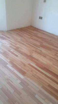 Wooden floor installation sanding and polishing services. image 9