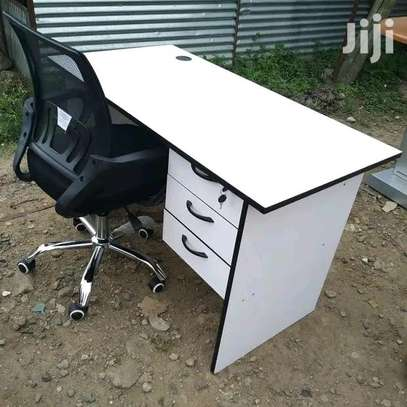 Adjustable swivel chair plus a good quality computer desk white image 1