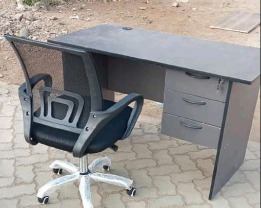 An office desk with a Dallas black adjustable ergonomic chair image 1