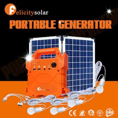Felicity Portable Solar Generator 20W Panel + 4 LED Bulbs + Radio + MP3 Player And  Supports 12VDC TV