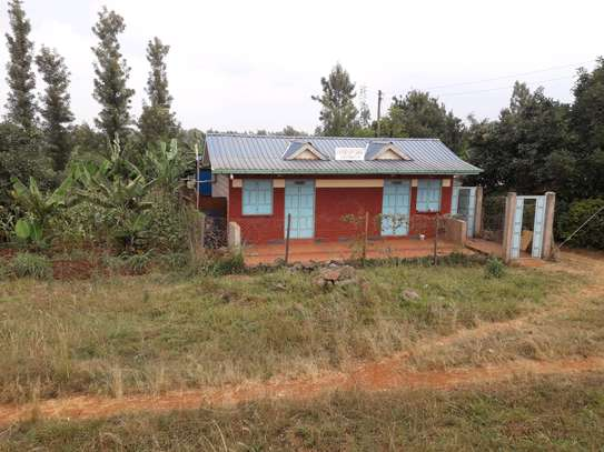 1 acre Land for  sale with a 3 bedroom house