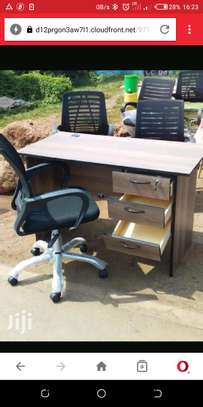 Brown study desk with 3 side drawers plus adjustable office chair image 1
