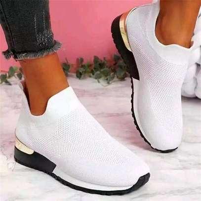 White slip on sneakers image 1