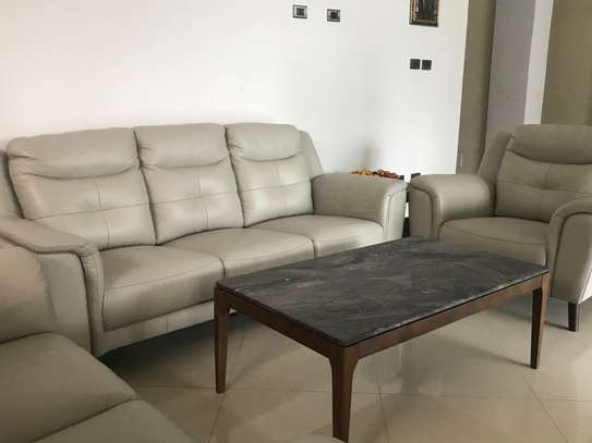 6 seater leather sofa set, coffee table set (one center and two corners) and dining set marble top table with six chairs. image 3
