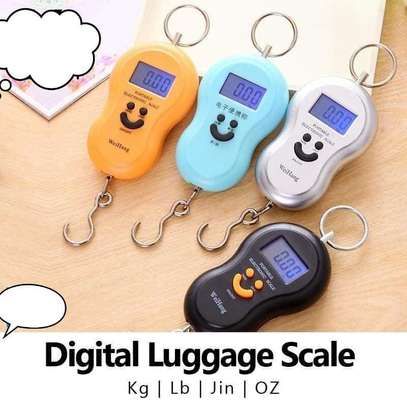Portable Digital Luggage Scale where it can be used for weighing your luggage or any item with a maximum weight of 110 lbs (50kg). image 1