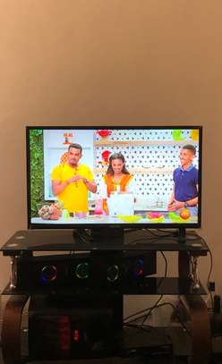 Used Super Fine TV 32 inch with TV stand and Gee-pas (two speakers) for sale