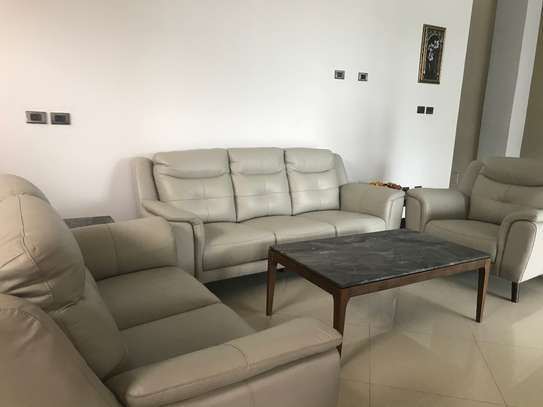 6 seater leather sofa set, coffee table set (one center and two corners) and dining set marble top table with six chairs. image 5