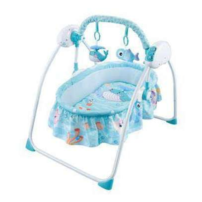 Remote controlled baby swing and bed