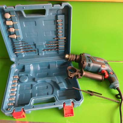 Drill with accessories and box new image 1