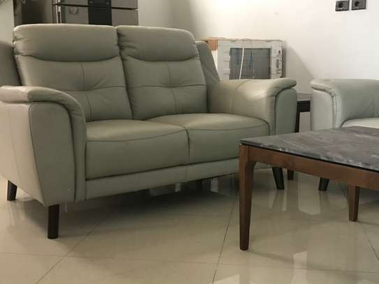 6 seater leather sofa set, coffee table set (one center and two corners) and dining set marble top table with six chairs. image 1