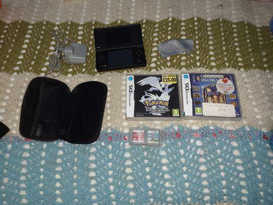 Nintendo DSi Game Console plus 4 Games