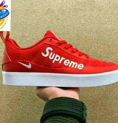 Red Nike Supreme Shoes