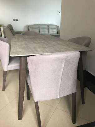 6 seater leather sofa set, coffee table set (one center and two corners) and dining set marble top table with six chairs. image 2