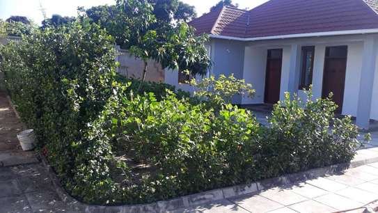 4 bed room house for sale at mapinga bagamoyo , house with big terrace and swimming pool image 11