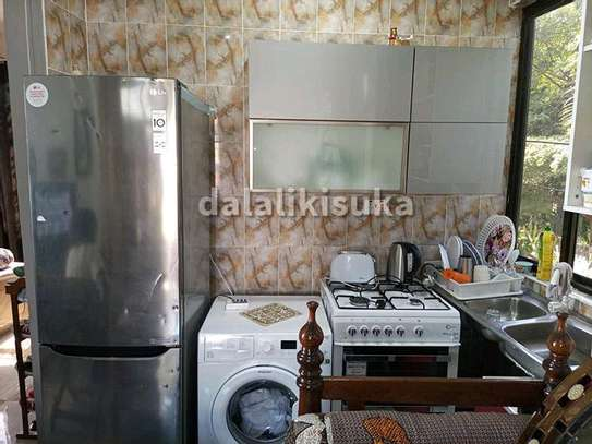 One bdrm and sitting room FURNISHED apart for rent at KINONDONI image 3